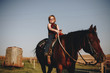 Young girl is enjoying a horse riding - 181077475