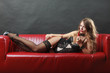 Woman wearing sexy black lingerie underwear holding pepper
