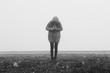 Woman with retro camera in a fog landscape