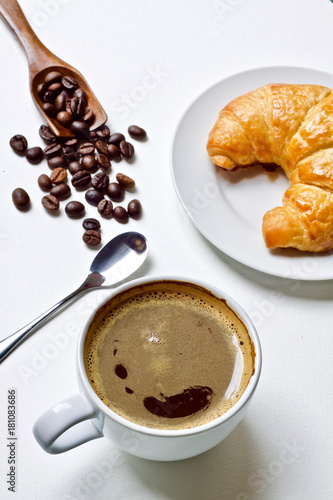 Coffee cup and croissant breakfast in the morning