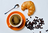 Coffee cup and croissant breakfast
