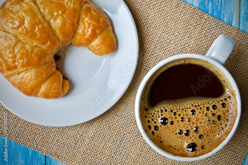 Wall mural Coffee cup and croissant breakfast