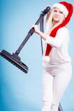 Girl in santa helper hat with vacuum cleaner - 181094488