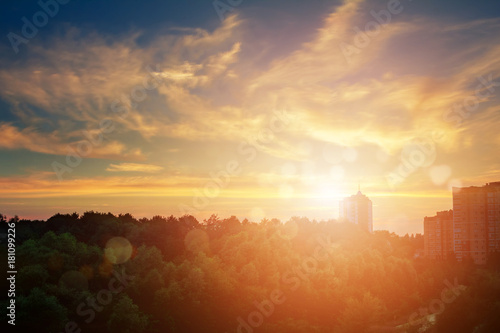 Outskirts of the city during the sunset. Natural summer landscape