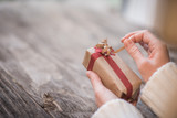 Woman's hands holding gift box and copy space - 181100676