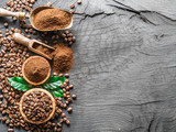 Roasted coffee beans  and ground coffee on wooden table. Top view. - 181103425