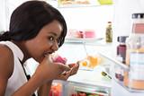 Woman Eating Slice Of Cake - 181108464