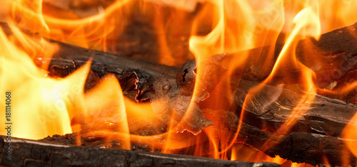 Burning and glowing charcoal with open hot flame and smoke