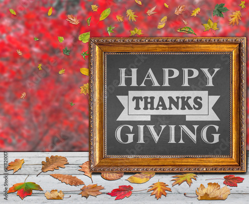 Happy Thanks Giving inside frame with red and colored autumn leaves in background