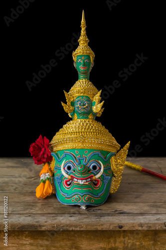 Poster Bangkok The mask of Thotsakan or Ravana, one of the demon king in Thai Ramayana pantomime on the wooden table isolated on black background