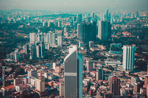 Staande foto Kuala Lumpur Modern architecture, business office building, cityscape background. Kuala Lumpur skyline. Travel to Malaysia. Urban skyscrapers. Modern city. Financial district. Aerial view of downtown. Toned