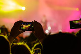 Concert visitor shoots video on a smartphone - 181128617