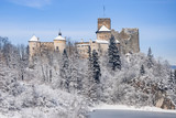 Medieval castle in Niedzica, Poland, in snow in winter on the rocky cliff at artificial Czorsztyn lake on Dunajec river.