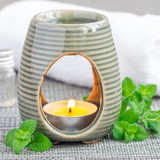 Peppermint essential oil in aroma lamp, square format - 181131454