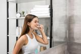Woman brushing teeth - 181135616