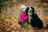 child hugs the dog - 181136495
