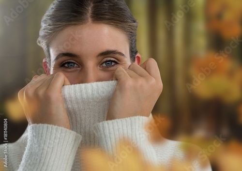 Woman's face in forest with leaves
