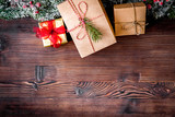 packaging christmas gifts in boxes on wooden background top view - 181142051