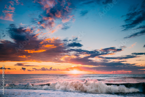 Foto op Canvas Zee zonsondergang Sun Is Shining Over Horizon At Sunset Or Sunrise. Evening Sea Or