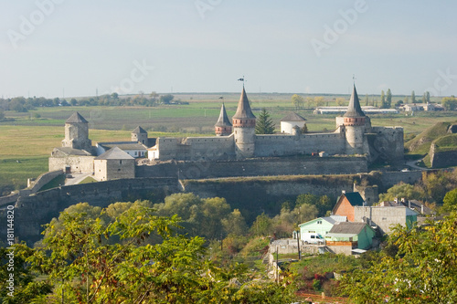 Summer view to castle in Kamianets-Podilskyi © bartoshd