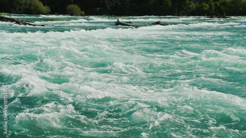 Beautiful water of the Niagara River. A clean river with a strong current in front of Niagara Falls