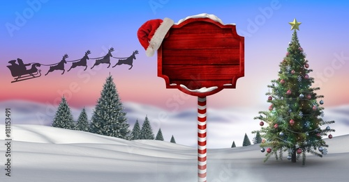 Plexiglas Lichtroze Wooden signpost in Christmas Winter landscape with Christmas