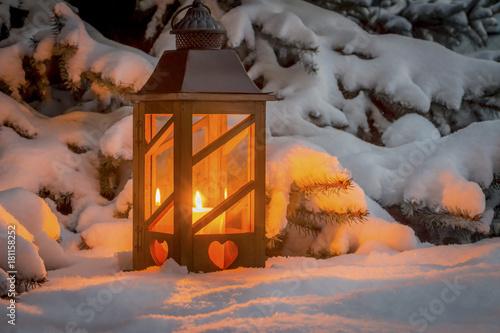 Leinwanddruck Bild lantern for christmas in the snow