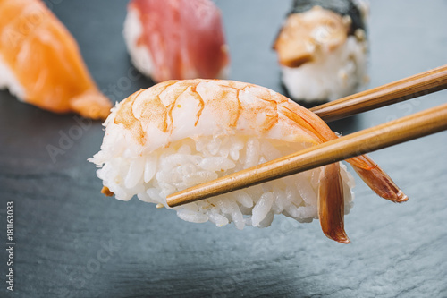 Nigiri sushi with chopsticks - 181163083