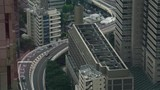 Tokyo city highway road next to skyscrapers cityscape buildings seen from above - 181168898
