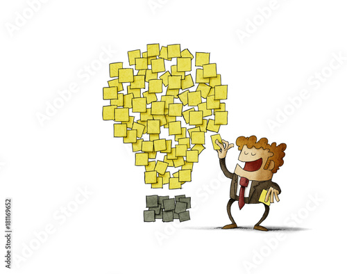 businessman sticks a post note next to others that are shaped like an idea. creativity concept. isolated