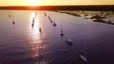 Aerial view passing over sailboats in Beaufort, South Carolina at sunset. - 181177025
