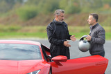 race engineer talking with pilot about strategy near lamborghini