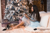Christmas letter writing on notebook. Many garlands. Christmas , winter holidays and people concept. Letter to Santa Claus. Girl writes her wish - 181189410