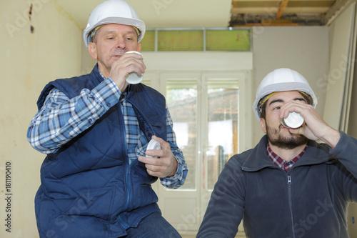 Poster builders on a break