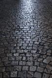 old cobblestone street at night vertical