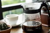 Closeup of coffee jar by the window - 181204480