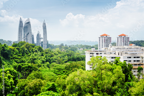 Beautiful cityscape in Singapore. Skyscrapers among green trees