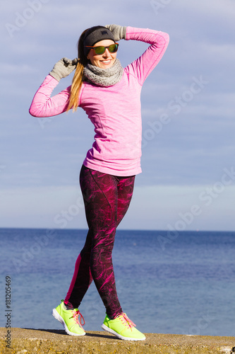 Poster Woman resting after doing sports outdoors on cold day