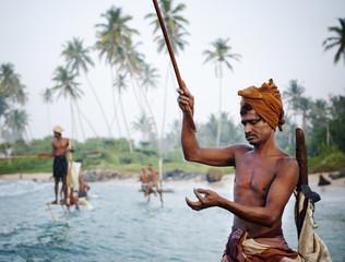 Traditional stilt fishermen in Sri Lanka.