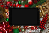 Blank tablet surrounded with Christmas decorations - 181212800