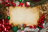 Blank paper surrounded by Christmas ornaments, decorations, and tree branches - 181212801