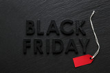 Black Friday text with red sale tag on slate background - 181212844