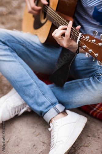 Fotobehang Muziek Music lifestyle man playing guitar concept. Stroller man at the nature. Artist instruments advertisement.