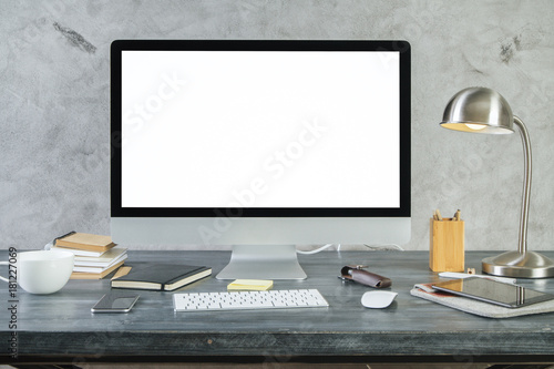 Desk with empty white pc monitor front
