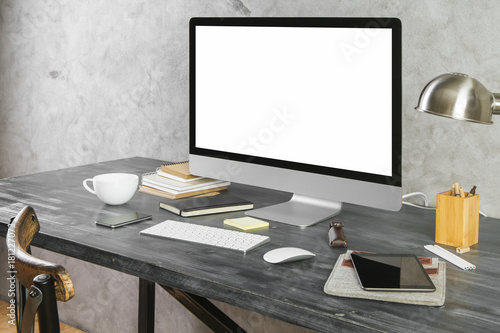 Desktop with empty white computer monitor side