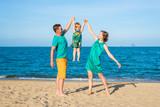 Happy family on the beach. Family look - 181228207