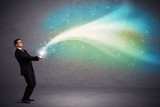 Businessman holding light - 181233616