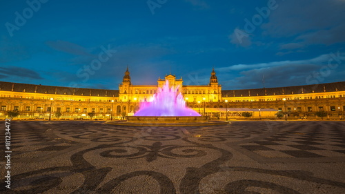 Night at Plaza de Espana, with violet moving fountain at sunset from dusk to night