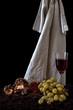 Natura morta uva, castagne e vino