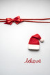 Quadro Merry christmas / Creative concept photo of santas hat and sign grey background.